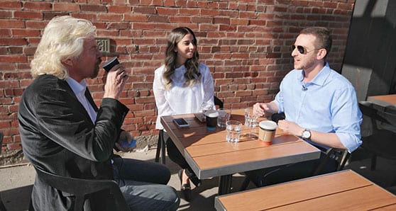 Stephanie and Alexander (middle) from Swob talk with Richard Branson. Branson endorsed Swob as the Number 1 social recruitment platform amongst millennial job seekers
